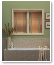 Decorative touches like adding cloth tapes to your blinds enhance privacy by covering rout holes and enhance your décor.