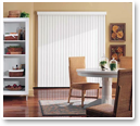 Preserve privacy by covering tall windows with vertical vinyl blinds.