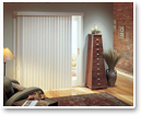 Vertical blinds clean up easily making them a good choice for high traffic areas like sliding doors.