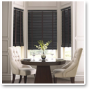 Dark wood blinds with cloth tapes echo the wood table and chair legs to complete the look of this dining area.